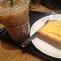 Photo taken at Starbucks by Naoko Y. on 3/23/2014