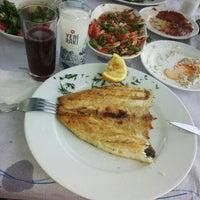 Photo taken at mavi kum restaurant by Gül C. on 8/9/2015