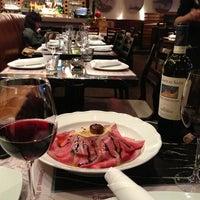 Photo taken at Trattoria Italian Kitchen by Helen L. on 12/28/2012
