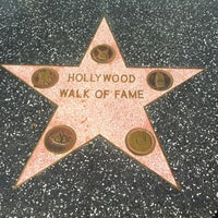 Photo taken at Hollywood Walk of Fame by Kylie B. on 12/15/2012