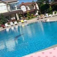 Photo taken at Akarsu Villaları Havuz Başı by Sevil A. on 7/26/2015