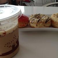 Photo taken at Moko Donuts and coffee by Ika Taruna S. on 8/24/2013