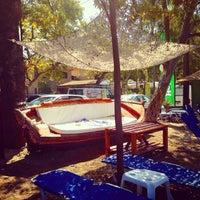 Photo taken at Catamaran Beach Cafe by Dilek B. on 7/29/2014