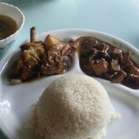 Photo taken at Tipanan Filipino Restaurant by Awiee B. on 12/28/2014
