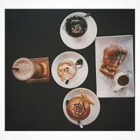 Photo taken at Wild Coffee & Tea by Jing H. on 9/3/2014