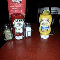 Photo taken at St. Louis Bar and Grill by Jeff E. on 4/4/2013