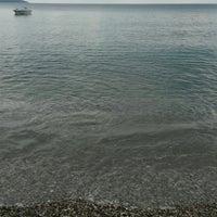 Photo taken at Plaka Beach by Panagiotis T. on 8/25/2016