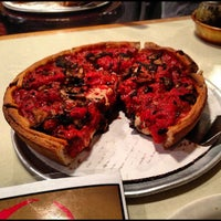 Photo taken at Zachary's Chicago Pizza by Tarren B. on 10/15/2012