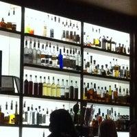 Photo taken at The Corner Office Restaurant & Martini Bar by Krea S. on 11/10/2012