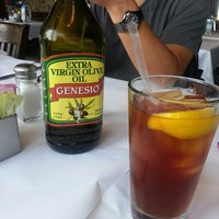 Photo taken at Romano's Macaroni Grill by Sunee L. on 7/4/2013