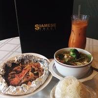 Photo taken at Siamese Street Restaurant by Amanda C. on 3/11/2014