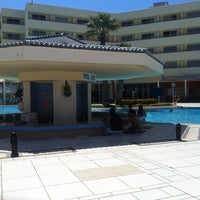 Photo taken at Hilton Plaza Pool Bar by Nikolay K. on 9/8/2014