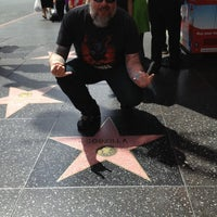 Photo taken at Godzilla's Star, Hollywood Walk of Fame by Kyle Y. on 4/15/2013