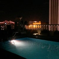 Photo taken at Le Pavillon rooftop pool by Mimi M. on 11/1/2014