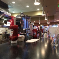 Photo taken at Johnny Rockets by Shehab P. on 6/23/2014