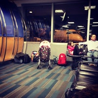 Photo taken at Gate A1 by Mathieu H. on 12/20/2012