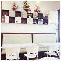 Photo taken at The Spring Cafe & Resto by Fanny T. on 3/22/2014