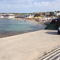 Photo taken at Mambo Beach Club by Deniz D. on 10/13/2013