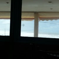 Photo taken at Café Surf Beach by Karim Y. on 3/23/2013