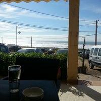 Photo taken at Café Surf Beach by Karim Y. on 3/30/2013