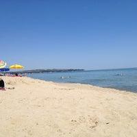 Photo taken at Aurora Beach by Denimir K. on 6/23/2013