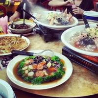 Photo taken at Restoran Kari Kepala Ikan Tiga by Desmond Y. on 2/26/2013