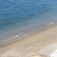 Photo taken at Esenköy Kaya Garden Beach by Huseyin A. on 7/11/2014