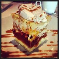 Photo taken at Carlitos Gardel Restaurant by Jamie on 7/5/2013