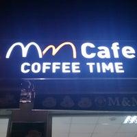Photo taken at M&M Cafe by Yasemin A. on 6/25/2014