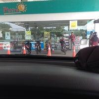 Photo taken at Petronas Taman Yayasan by Nik M. F. on 5/17/2014