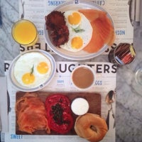 Photo taken at Russ & Daughters Café by Saad K. on 7/25/2015