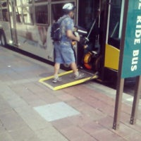 Photo taken at 4th and Nicollet Mall Bus Stop by Judy S. on 9/11/2013