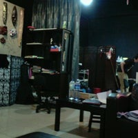 Photo taken at Black Ink Industry Tattoo Shop by jin yin on 10/21/2012