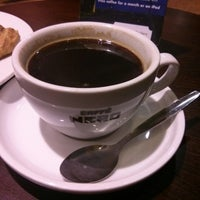 Photo taken at Caffè Nero by Thomas B. on 10/18/2013