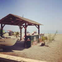 Photo taken at Playa El Candado by Lorena O. on 7/22/2013