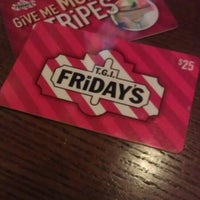 Photo taken at TGI Fridays by Christie L. on 3/24/2013