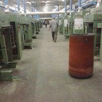 Photo taken at Misr for Spinning & Weaving (El Mahalla El Kobra Factories) by El M. on 9/18/2013
