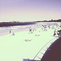 Photo taken at Mooloolaba Beach by Josh P. on 1/8/2013