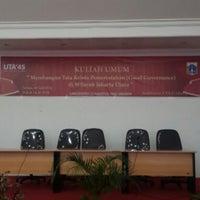 Photo taken at Universitas 17 Agustus 1945 (UTA'45) by Acank U. on 7/8/2014