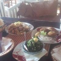 Photo taken at Arabian Taverna by Irena B. on 12/24/2014