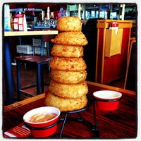 Photo taken at Red Robin Gourmet Burgers by Caitlyn M. on 5/13/2013