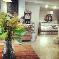 Photo taken at Tela's Market & Kitchen by Shannon C. on 12/7/2013
