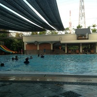 Photo taken at Manyar swimming pool by Claudine K. on 8/30/2013