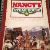 Photo taken at Nancy's Steak House by Mary B. on 12/19/2013