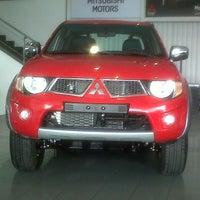 Photo taken at Motorysa Mitsubishi Colombia by Fernando M. on 8/28/2013