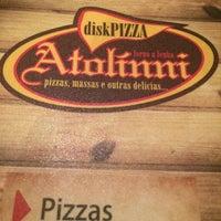 Photo taken at Atolinni Pizzaria by Scheila L. on 6/2/2014