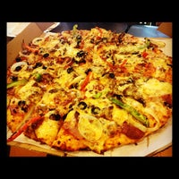 Photo taken at Yellow Cab Pizza Co. by Tata A. on 12/2/2012
