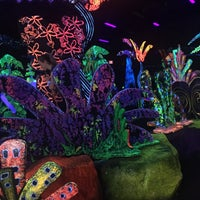 Photo taken at Putting Edge Glow-in-the-Dark Mini Golf by Carm N. on 3/20/2016