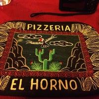 Photo taken at El Horno by Marita A. on 12/3/2012