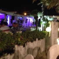 Photo taken at Nettuno Beach Club by Lorenzo D. on 8/11/2014